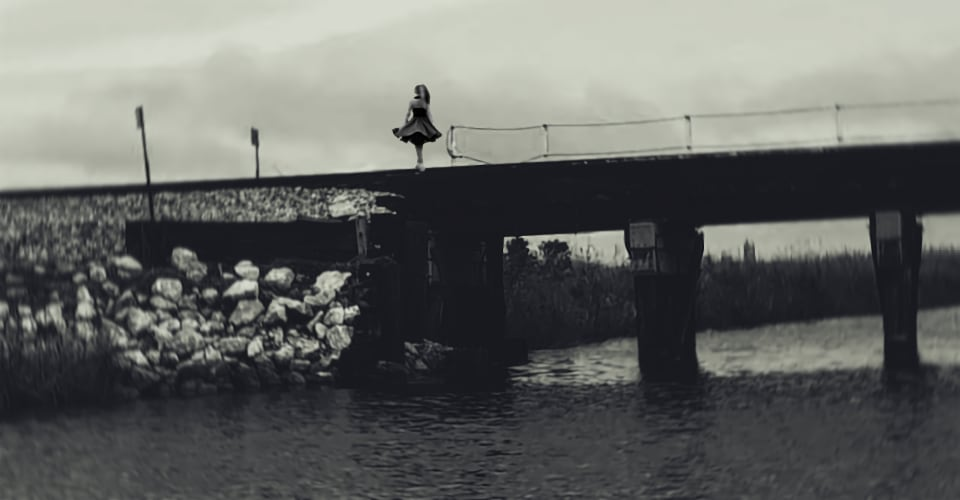 woman on a bridge