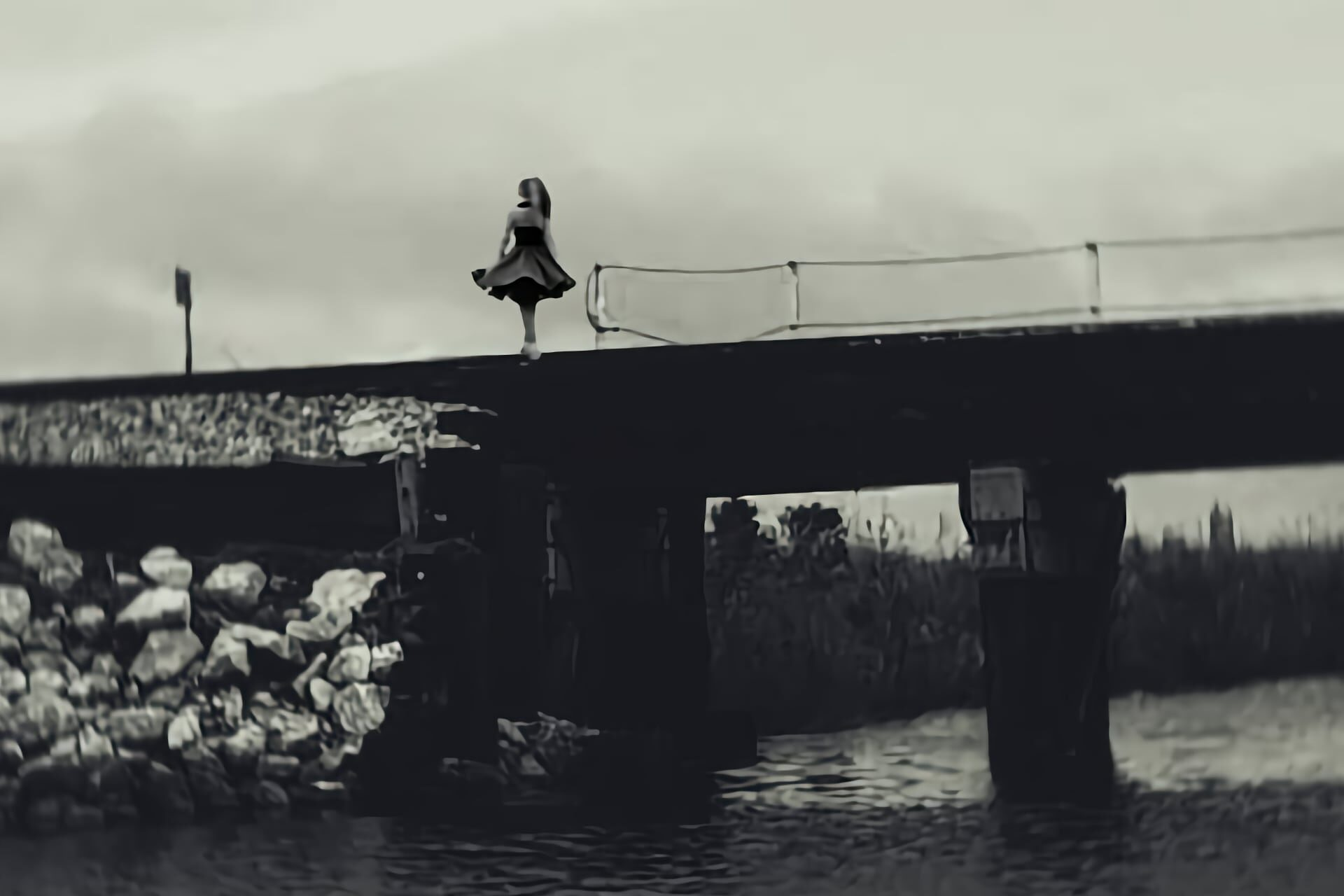 Ghostly woman on a bridge over a river